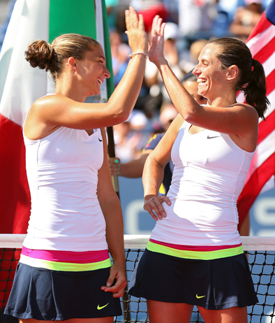 NEW YORK, NY - SEPTEMBER 09: Sara Errani and Roberta Vinci of Italy tap hands before receiving the trophy following their victory against Andrea Hlavackova and Lucie Hradecka of the Czech Republic in their women's doubles final match on Day Fourteen of the 2012 US Open at USTA Billie Jean King National Tennis Center on September 9, 2012 in the Flushing neighborhood of the Queens borough of New York City. (Photo by Cameron Spencer/Getty Images)
